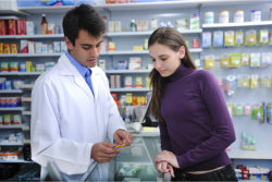 pharmacist with a young girl