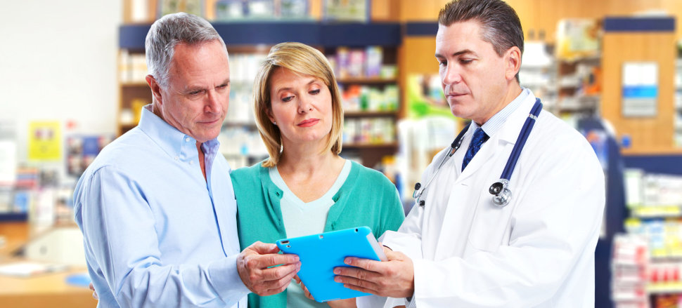 a pharmacist with a customer